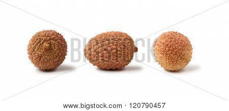 Three lychee fruits isolated on a white background