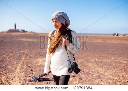 Female photographer walking outdoors