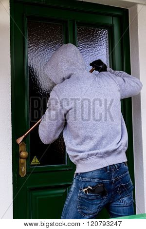 burglar at a house door