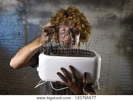 young man electrocuted trying to get toast out of toaster with knife suffering domestic accident with dirty burnt face in funny shock expression screaming crazy in electricity danger concept
