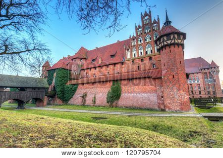 The Castle of the Teutonic Order in Malbork at sunset, Poland
