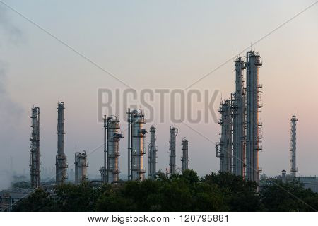 Process Columns of Natural Gas Plant with morning sky in background
