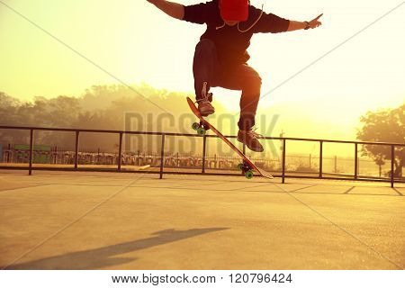 one young skateboarder skateboarding at sunrise skatepark