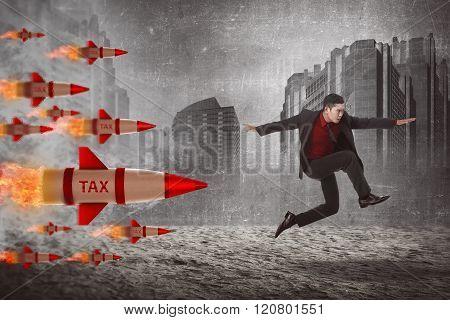 Asian Business Man Jump From Tax Rocket