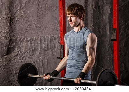 Man Makes Exercises For Biceps With Weights.