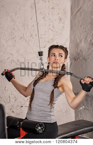 Girl Is Engaged In Fitness On A Simulator.