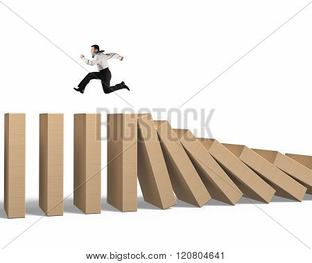 Man Running On Falling Wooden Dominoes