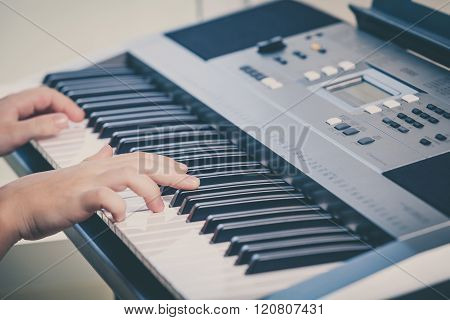 Little Girl Playing Synthesizer