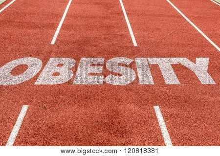 Obesity written on running track