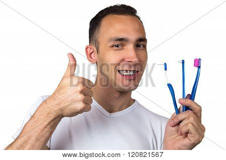 Happy man with toothbrushes