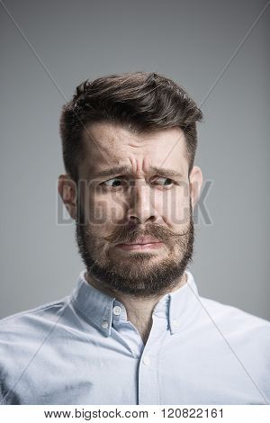 portrait of disgusted man