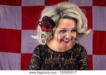 Ruffled laughing woman with smudged make up