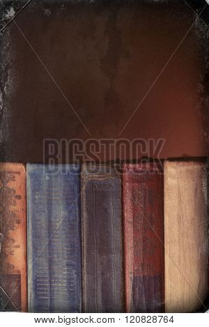 Old books on brown background