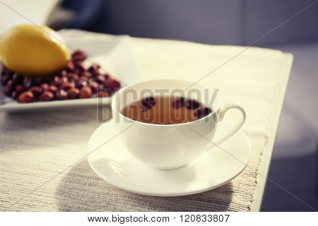 Rose hip and lemon tea on table in the room