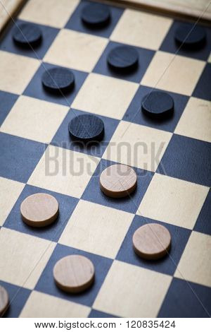 Color shot of a vintage draughts or checkers board game.