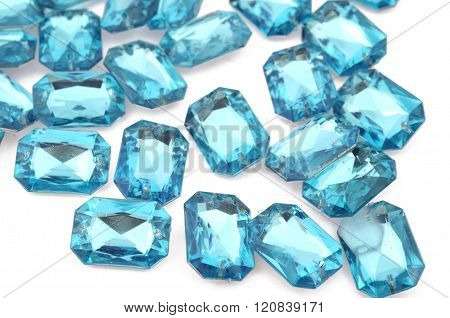Blue rhinestone on white background