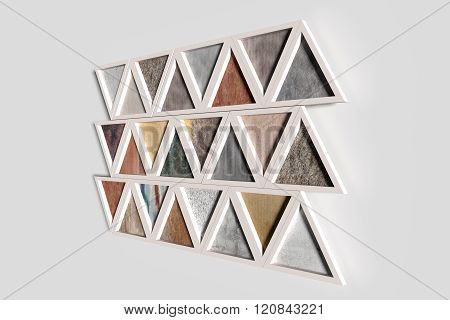 Wall With Triangles Of Different Materials In White Frames