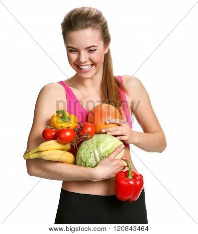 Portrait of cute smiling woman with fresh fruits and vegetables.