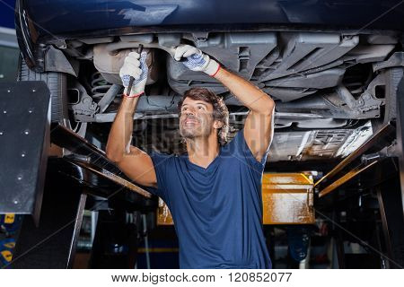 Mechanic Repairing Underneath Car