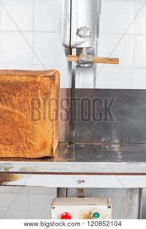 Bread On Cutting Machine In Bakery