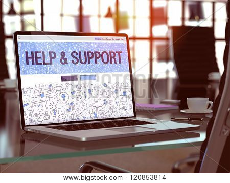 Help and Support on Laptop in Modern Workplace Background.