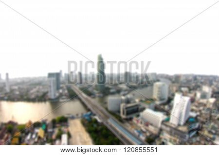Blurred City And Buildings With Chao Phraya River Background