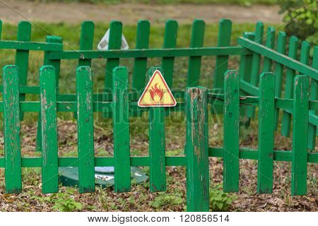 Fire warning sign on the wooden fence