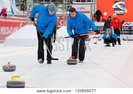 Curling Players Kirill Savenkov (l) And Alexey Kulikov (r)