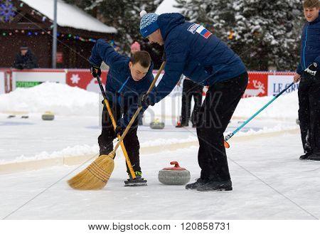Curling Players A. Kirikov (l) And S. Morozov (r)