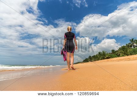 Woman Holding Mask And Flippers For Swimming On The Background The Azure Sea