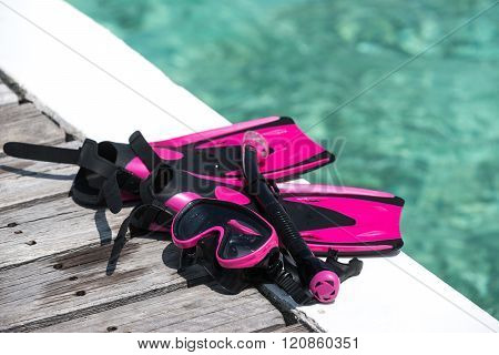 Scuba Mask With Pink Flippers On Wooden Pier Background