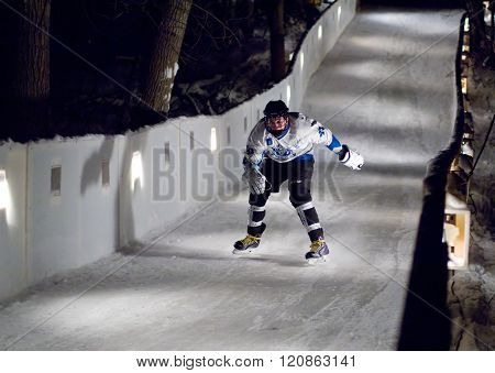 MOSCOW - JANUARY 16: Unidentified sportsman skate downhill during Ice Cross Downhill World Championship on January 15 2016 in Moscow Russia