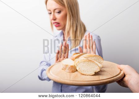 Woman refusing to eat bread