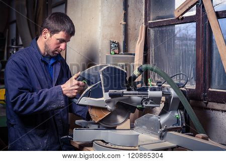 Carpenter Man Using Circular Saw