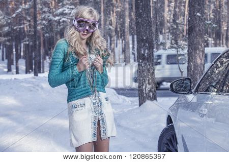 Model Beautiful Woman In Fashionable Clothes And Accessories For Skiing On The  Skiing In Winter