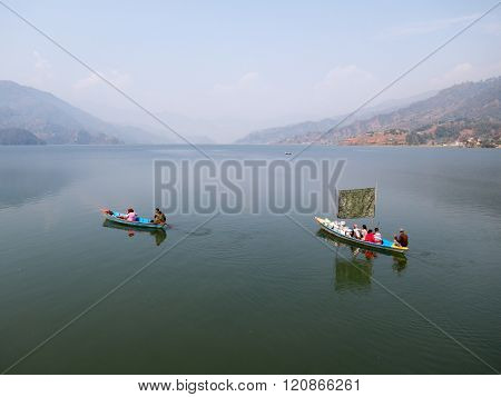 Boaters On A Lake