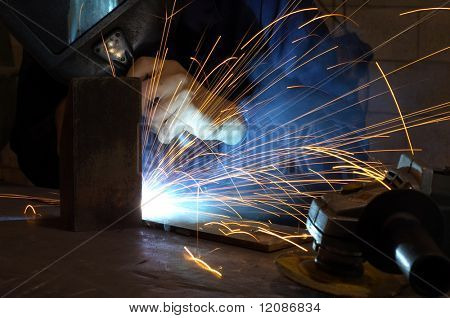 Busy welder in the middle of his job