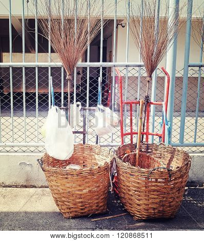 Old Broom And Plastic Bags In Trash Basket Or Trash Can In Red And Blue Cart On Street With Vintage