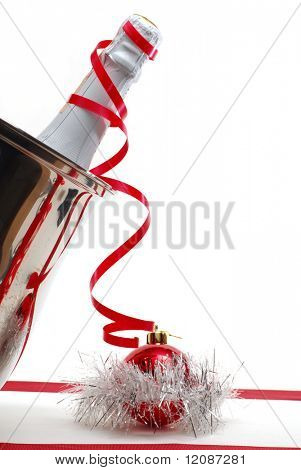 Champagne and Christmas decoration on white background
