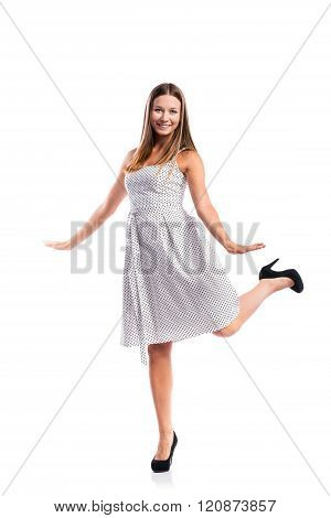 Girl in black-and-white dotted dress, heels, studio shot, isolat