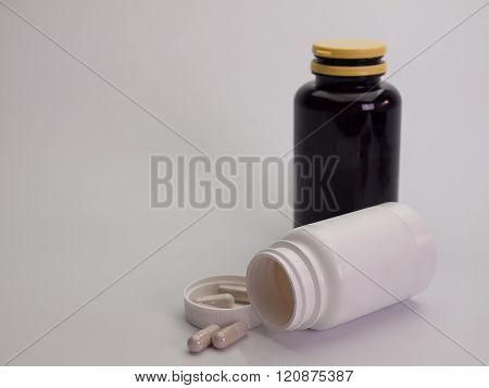 Medicine bottles and piles