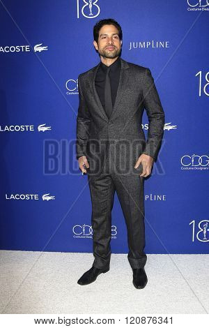 LOS ANGELES - FEB 23: Adam Rodriguez at the 18th Costume Designers Guild Awards at the Beverly Hilton Hotel on February 23, 2016 in Beverly Hills, California