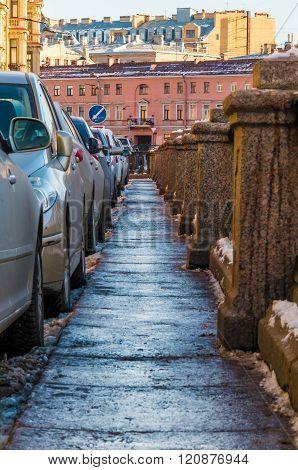 Sidewalk on granite embankment of canal