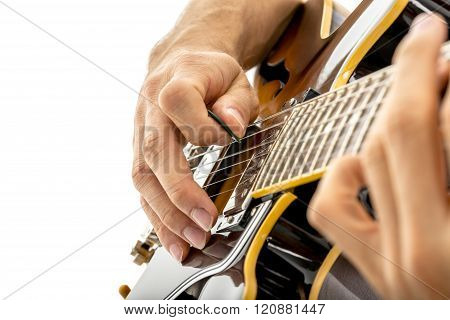 Male Guitarist Playing Black Guitar Using A Pick