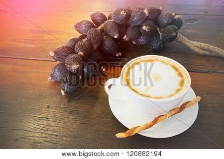 Hot Coffee In Cup And Twisted Sweet Stick Biscuit And Fruit Decoration Wooden Table With Filtered Im