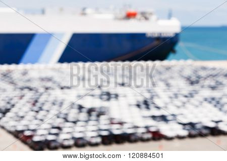 Blurred New Cars Waiting To Export Via Ship