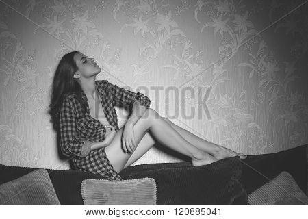 Sexy Girl On Backrest Of Sofa Monochrome Shot