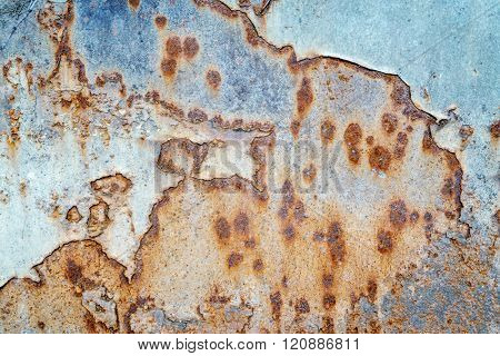 blue grunge painted metal texture of junk car body