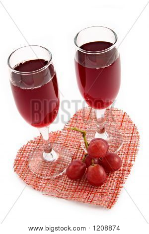 Red Wine And Grape On A Background Of Heart