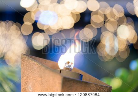 Flaming Torch On Beautiful Bokeh Background